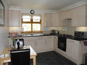 One bedroom lodge kitchen/dining area at Bracken Lodges Self-Catering Holiday Loch Tay Kenmore Killin Perthshire